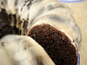 Cross section of double chocolate amaretto bundt cake with glaze